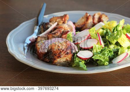 Grilled Meat Kebab And Healthy Vegetable Salad Of Fresh Radish, Onion, Lettuce On Brown Background