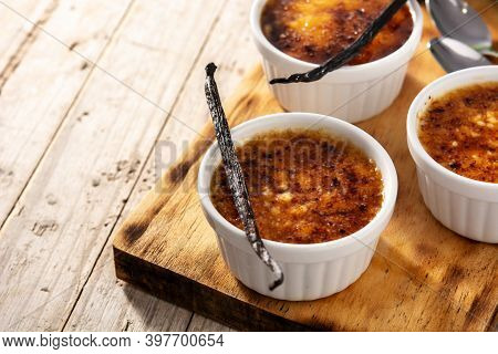 Homemade Creme Brulee In Bowl On Wooden Table.copy Space
