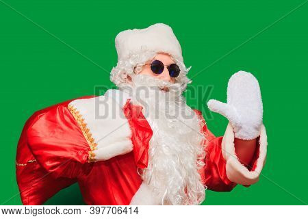 Waist Up Portrait Of Bearded Old Man In Santa Costume Carrying Big Sack With Christmas Presents. Iso