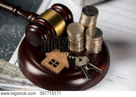 Judge Gavel, Coinsand Wooden Model Of House. Concept Of Real Estate Auction Or Dividing House When D