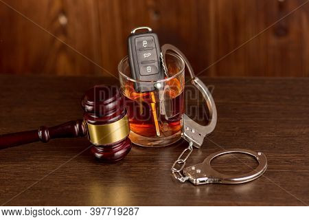 Whiskey With Car Keys And Handcuffs. Concept For Drinking And Driving