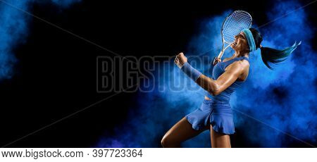 Woman tennis player celebrating winner on smoke background. Sports banner. Horizontal copy space background