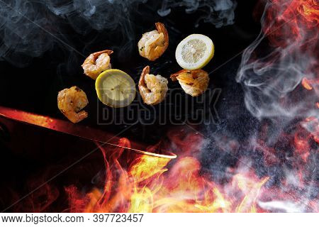 Stir Frying And Tossing Shrimp With Sliced Lemon Concept With Steam Smoke And Flames