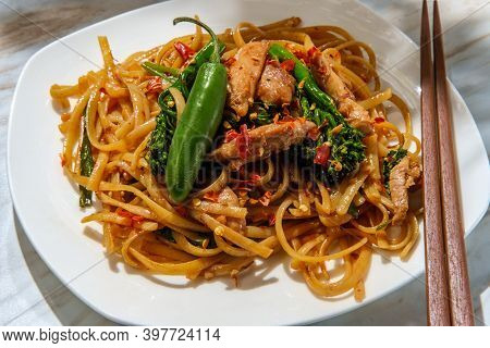Pad Kee Mao Otherwise Known As Drunken Noodles Is A Spicy Thai Stir-fried Noodle Dish With Thinly Sl