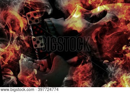 Skull Burning In Hell With Gambling Dice Addiction Concept