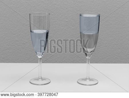 Two Glasses, One Half Full Other Half Empty Showing Concept Of Optimistic Or Pessimistic Attitude.