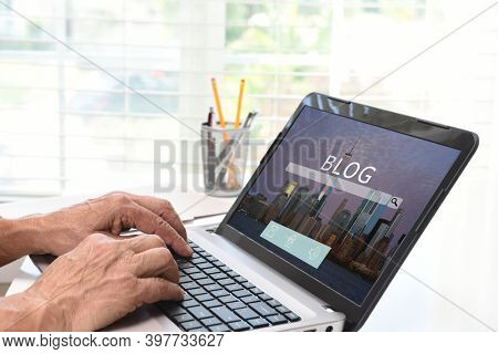 Blogging concept. Closeup of a man's hands typing on a computer making entries on his personal website.