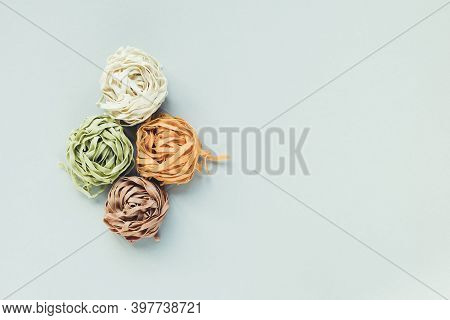 Raw Traditional Italian Tagliatelle Pasta Noodles Nests Of A Different Color - Spinach, Potato, Carr