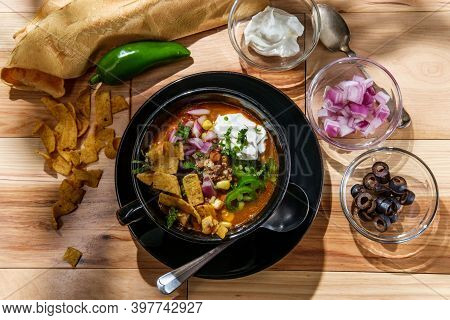 Mexican Beef Taco Soup With Pinto Beans And Garnishes