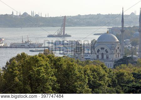 Beautiful Ottoman Dolmabahce Mosque Of Bezmialem Sultan And Dolmabahce Clock Tower, Located On The S
