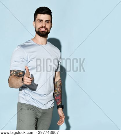 Positive Handsome Brutal Man In Comfortable Stylish Casual Clothes With Tatoo On Hands Standing And