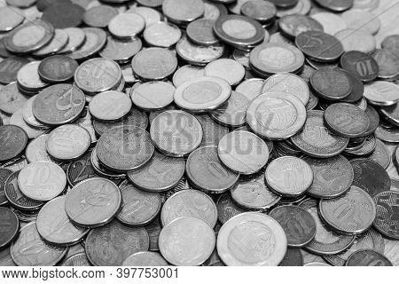 Plenty Of Coins Together (golden, Silver And Copper Coins). The Currency Is