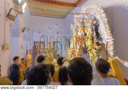 Blurred Image Of Flowers Thrown And Pushpanjali Being Offered By Hindu Devotees To Goddess Durga At
