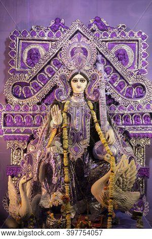 Idol Of Goddess Saraswati With Veena, A Musical Instrument And White Swan, A Sacred Bird, At Kolkata
