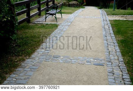Beige Threshing Path Gravel With Delimited Edges Granite Cubes In A Row And Dividing Channels From T