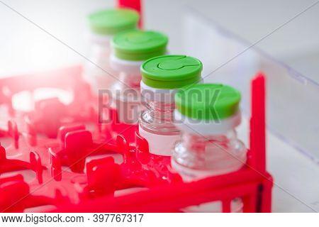 Lab Bottle Vaccine On A Dry Ice Storage.