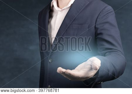 Businessman With Empty Hand. An Empty Workpiece. Blue Glow In The Empty Open Hand Of A Businessman.