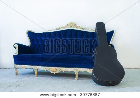 Blue Sofa And Guitar Case