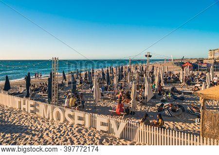 Adelaide, South Australia - January 12, 2019: People At The Moseley Beach Club Bar Enjoying Sunset V