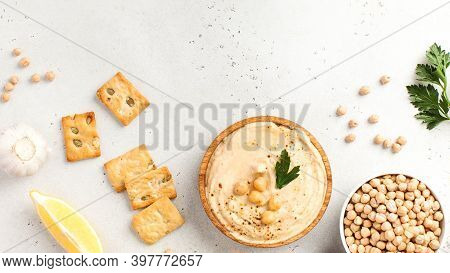 Flatlay Hummus In A Wooden Plate, Chickpeas, Croutons. Dishes Of Chickpeas, A Vegetarian Dish. Copy