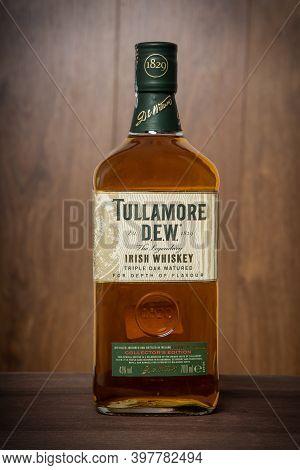 Varna, Bulgaria - November 14, 2020: Tullamore Dew Whiskey Bottle On Wooden Background. Tullamore De