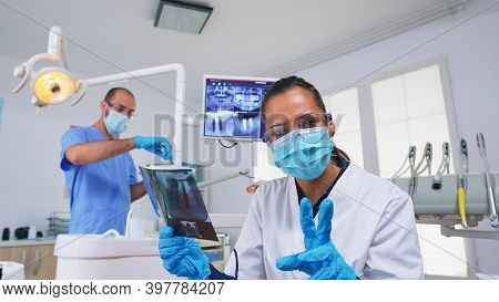 Patient Pov Looking At Dentist Asking For Dental X-ray Showing Teeth Image. Stomatology Specialist W