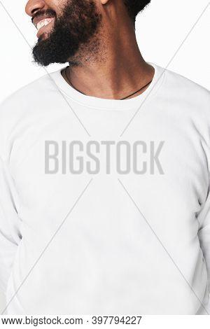 Size inclusive men's fashion white jumper studio shot
