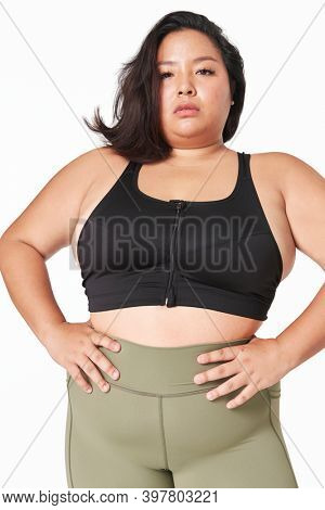 Attractive curvy woman sportswear apparel studio shot