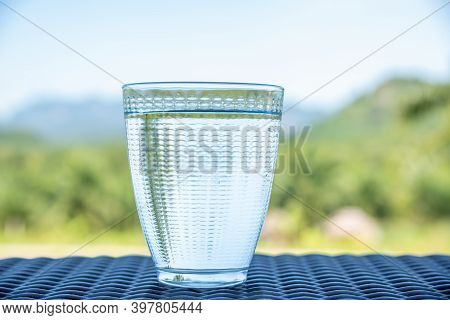 A Glass Of Clean Water, On The Nature Background