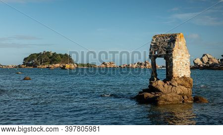 The Oratory St Guirec In Ploumanach Was Built In The 13th Century. It Is Flooded During High Tide