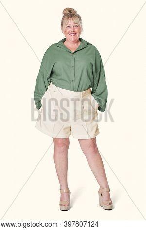 Size inclusive women's fashion green shirt studio shot