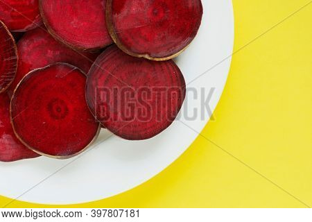 Round textured slices of beetroot on a plate