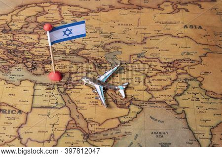 The Flag Of Israel And The Plane On The World Map.