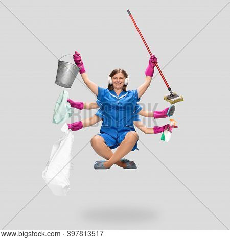 Music. Female Housemaid In Blue Uniform Multitask Like Shiva Isolated On Gray Background. Young Woma