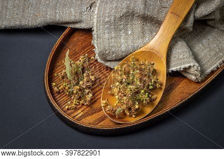 Dried Linden On A Wooden Spoon. Linden On A Wooden Surface. Healing Herbs.