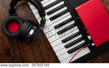 Piano, Headphones And Sound Card. Home Music Studio Concept.