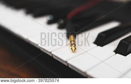 A Headphone Jack On The Musical Keyboard.