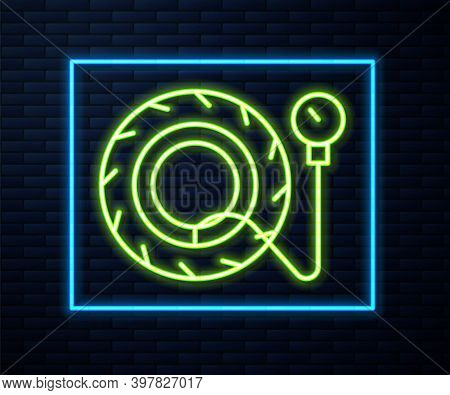 Glowing Neon Line Tire Pressure Gauge Icon Isolated On Brick Wall Background. Checking Tire Pressure