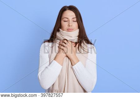 Upset Young Woman In White Casual Shirt, Wrapped In Scarf, Having Sore Throat, Holding Hand On Her N