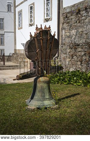 An Ancient Bell On The Grass In The Grounds Of The Convent Of Saint Francis, Santiago De Compostela,