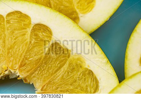 Pieces Of Yellow Pomelo Close-up. Citrus Yellow Fruit. Textured Background From Pomelo.