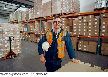 Male Engineers Smiling At Factory Warehouse Looking At Camera With Safety Helmet