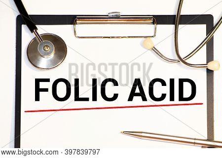 Folic Acid Written On A Clipboard, Medical Concept.