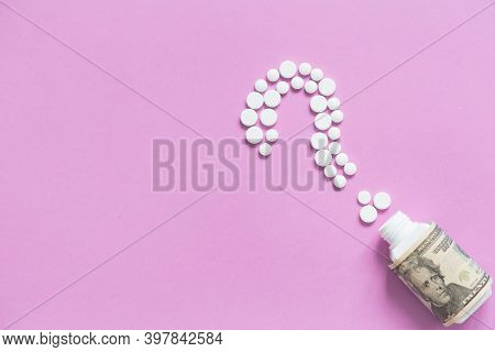 Medical Bootle With Dollars, Sign Of Question From White Pills. The Concept Of Insurance Medicine, H