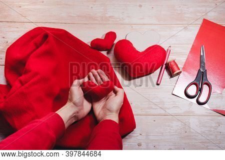 Step By Step Instruction. Diy Concept. Hold Hand Made Red Toy Heart Made Of Fleece Fabric. Step 8. M