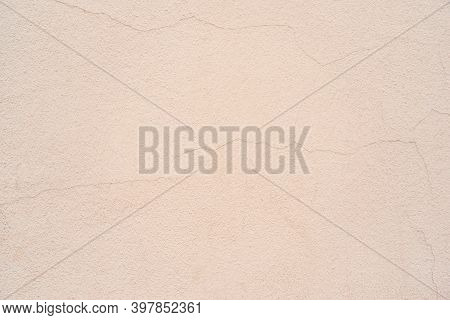 Old Plastered Wall Surface With Thin Cracks For Rough Textured Background Or Pale Wallpaper
