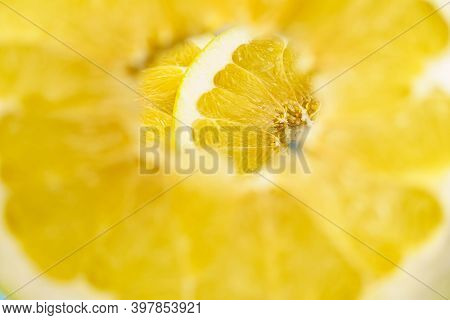 Pomelo Slices Through The Hole In The Pomelo. Yellow Citrus