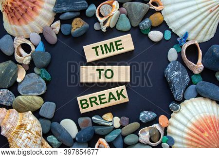 Time To Break. Words 'time To Break' On Wooden Blocks On A Beautiful Black Background. Sea Stones An