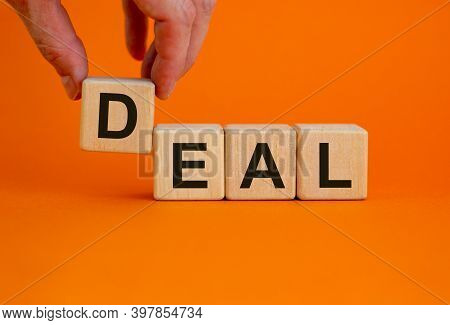 Fees Symbol. Concept Word 'fees' On Cubes On A Beautiful Orange Background. Male Hand. Business And