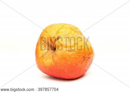 A Picture Of An Ordinary Apple, Without Modifications The Apple Is Old, Dry An Not Attractive. It Is